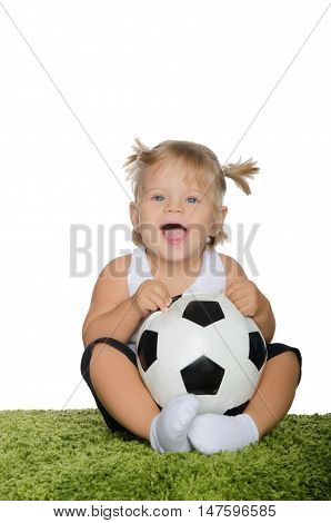 little girl with soccer ball on white background