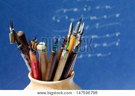 Old style fountain pens nib collection abstract letters background. macro view shallow depth of field