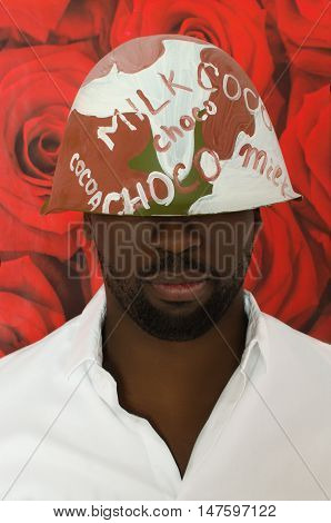 black in chocolate helmet on red floral background