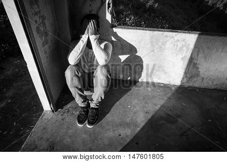 scared and alone, young Asian child who is at high risk of being bullied and abused, vintage