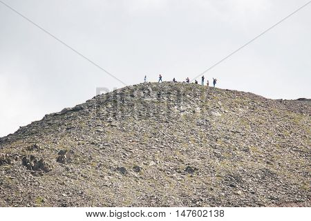 Dombay Russia 22 August 2016 people are photographed on a hilltop in the daytime