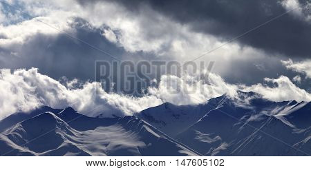 Panoramic View On Evening Mountains In Clouds