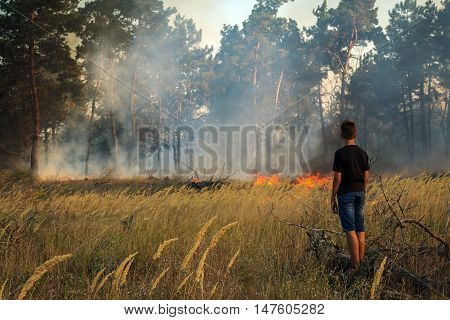 guy in dangerous proximity to a forest fire