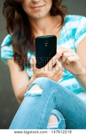 Woman is using her smartphone