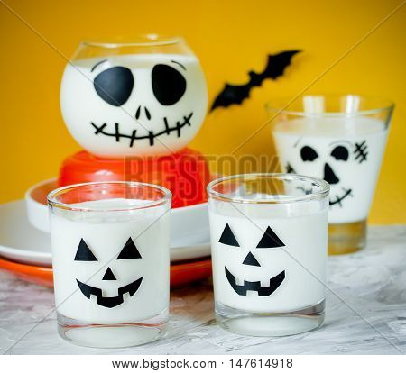 Halloween cup with white dessert or drink Halloween table setting