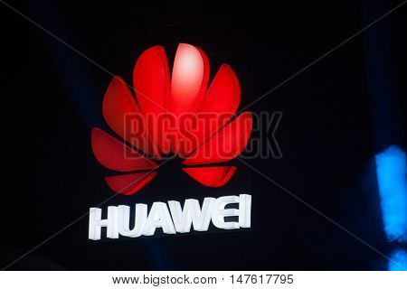 SHANGHAI CHINA - AUGUST 31 2016: The logo of Huawei company above stage of Connect 2016 information technology conference in Mercedes-Benz Arena in Shanghai China on August 31 2016.