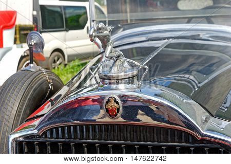 Kharkiv Ukraine - May 22 2016: Close up of the hood ornament of retro car Packard Single Eight 143 manufactured between 1924 and 1931 is presented at the festival of vintage cars Kharkiv Retro Rally - 2016 in Kharkiv Ukraine on May 22 2016