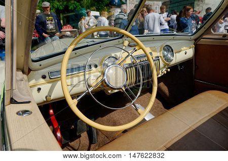 Kharkiv Ukraine - May 22 2016: Inside view of Soviet retro car phaeton GAZ-12 (ZIM) manufactured in 1949 is presented at the festival of vintage cars Kharkiv Retro Rally - 2016 in Kharkiv Ukraine on May 22 2016