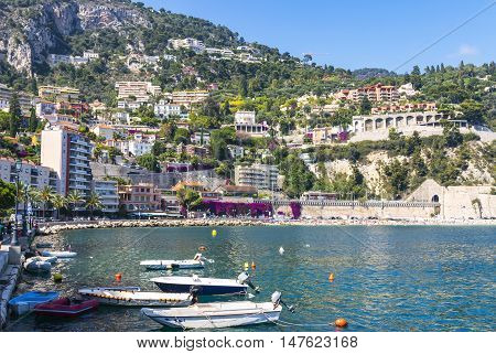 Panoramic view of summer coastline and beach in Villefranche-sur-Mer luxury resort near City of Nice Cote d'Azur France