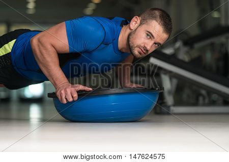 Personal Trainer Doing Pushups With Bosu Balance Ball