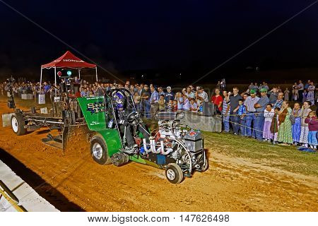 MYERSTOWN PENNSYLVANIA - SEPTEMBER 16 2016: A young man drives a custom made pulling tractor at Myerstown East End Days. The tractor pull is an annual community event.