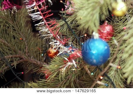 glass Christmas tree decorations on festive background