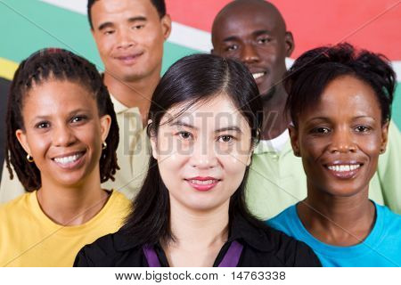 group of young South African people standing in front of South Africa flag, 2010 concept