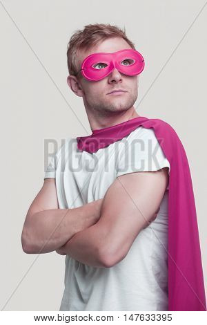 Superhero wearing pink cape and mask