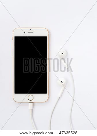 CHIANGRAI THAILAND -SEPTEMBER 9 2016: Front view image of new Apple iPhone7 mockup and new Apple EarPods mockup on white background.