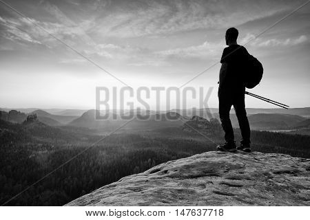 Man Hiker  At Mountain Peak. Marvelous Daybreak In Autumn Misty Landscape.
