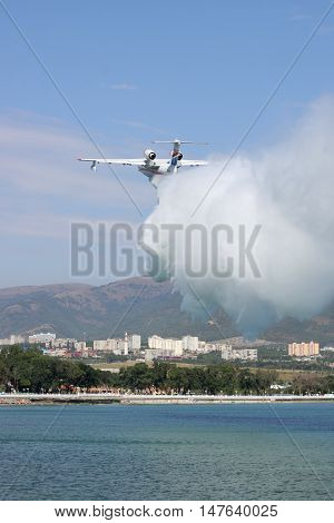 Gelendzhik Russia - September 9 2010: Beriev Be-200 amphibian planes is dropping a load of water to show its firefighting abilities