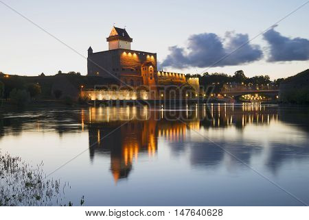 Vintage Herman's Castle and the river Narva, white night. Estonia