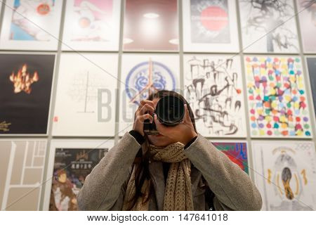 HONG KONG - JANUARY 29, 2016: woman taking photo at Hong Kong Heritage Museum. Hong Kong Heritage Museum is a museum of history, art and culture in Sha Tin, Hong Kong.