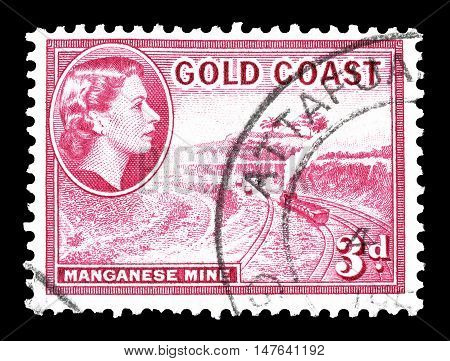 GOLD COAST - CIRCA 1952 : Cancelled postage stamp printed by Gold Coast, that shows Manganese mine.