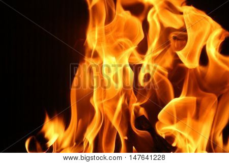 fire burns in the fireplace spurts of flame hellfire