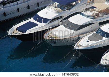 View on the prow of white yachts in harbor