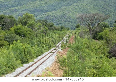 Picture of Railroad in countryside towards the mountains.