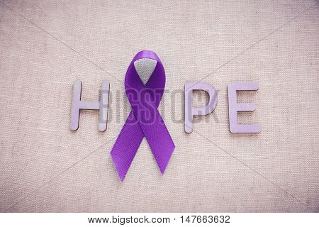 Purple ribbons with HOPE word Alzheimer's disease Pancreatic cancer Epilepsy awareness Hodgkin's Lymphoma awareness