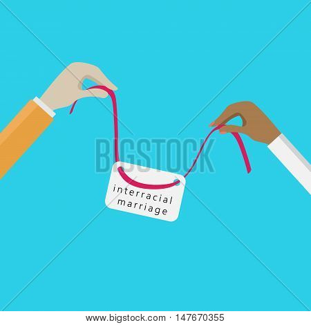 hands holding a silk red ribbon with the sign. interracial couples theme