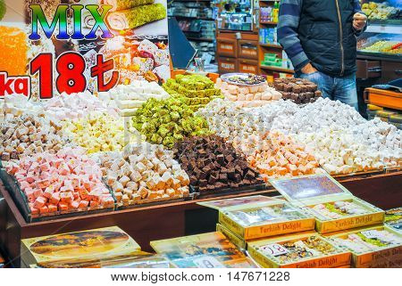 ISTANBUL THE CENTRAL MARKET - JANUARY 7/2016: Traders on the Istanbul market selling a variety of goods.