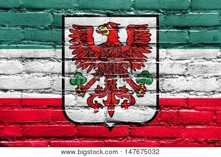 Flag Of Gorzow Wielkopolski With Coat Of Arms, Poland, Painted On Brick Wall