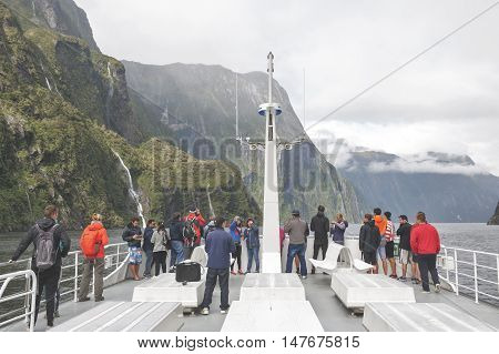 Milford Sound, New Zealand - February 2016: Tourists On Boat Cruises In The Fjord Of Milford Sound,