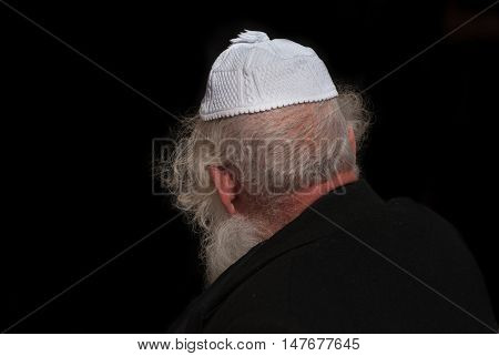 Orthodox Jewish man on black background Jerusalem. Israel