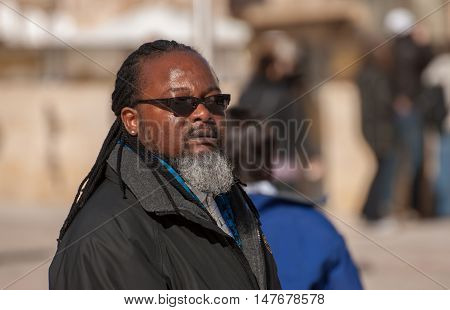 JERUSALEM ISRAEL - FEBRUARY 21 2012: Afro tourist at the Western Wall. Jerusalem. Israel