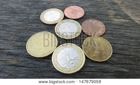 Euro Coins Over Wood Background