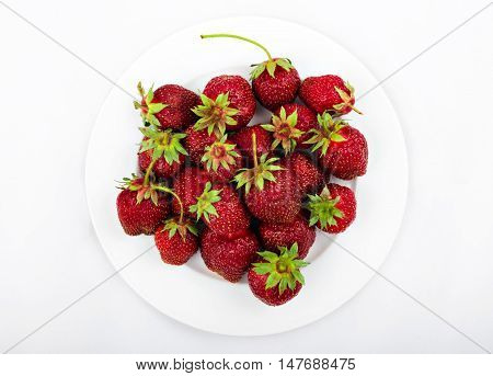 Fresh strawberry on the white plate and white background