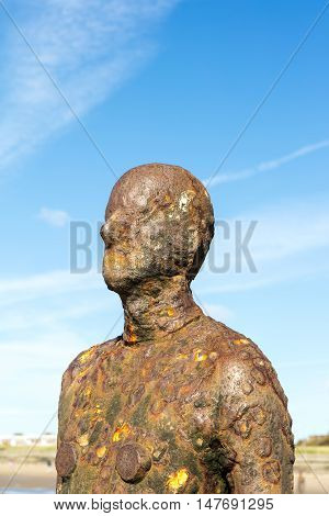 CROSBY BEACH, ENGLAND - SEPTEMBER 13: Detail of Another Place by Antony Gormley consists of 100 cast-iron, life-size figures spread out along three kilometres of the foreshore near Liverpool. on August 13, 2016.