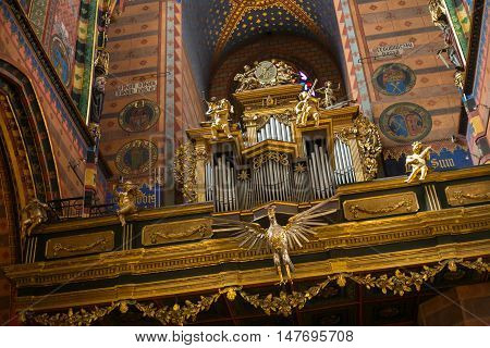 POLAND, KRAKOW - MAY 27, 2016: Vintage organ in the medieval St Mary's church in Krakow. St. Mary's Church was built in the XIII-XIV century.