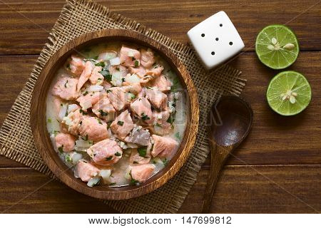 Chilean salmon ceviche prepared with onion garlic fresh coriander salt and lemon juice photographed overhead with natural light (Selective Focus Focus on the top of the ceviche)