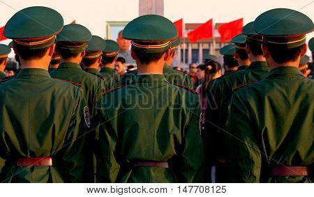 Beijing China - May 1 2005: Rows of Chinese soldiers stand at attention during the evening lowering of the flag ritual in Tiananmen Square