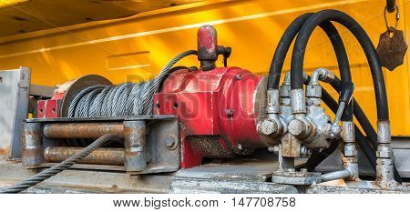 Detail photo of the red car winch.