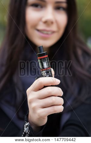 Young Girl Vaping E-cig Vaporizer Device