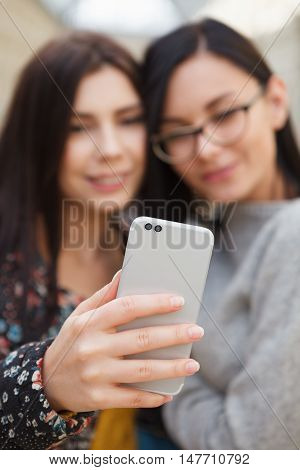 Girl Taking Selfie On Smart Mobile Phone With Dual Camera