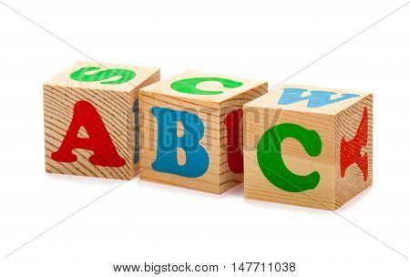 wooden blocks with alphabet letters. ABC. Isolated on white