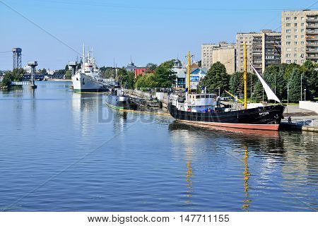 KALININGRAD, RUSSIA - SEPTEMBER 18, 2012: Ships and submarine berthed at the quay of Peter the Great. The tourist attraction of the city, favorite vacation spot townspeople.