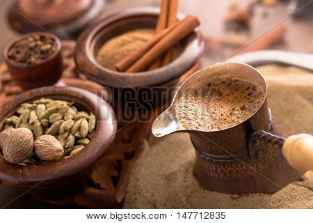 Coffee brewing in turkish pot and spices. Cezve