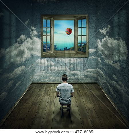 Abstract idea with a person sitting in a cloudy room looking to a opened window to another better and colorful world. Way to success symbol. Another reality concept