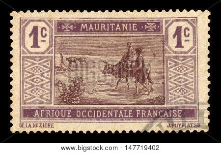 Mauritania - CIRCA 1913: A stamp printed in Mauritania shows native landscape. nomads  crossing desert, series, circa 1913