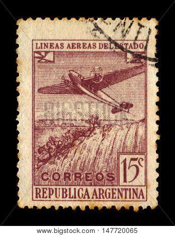 Argentina - CIRCA 1946: A stamp printed in Argentina shows plane over Iguacu falls, Argentina, circa 1946