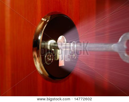 Key and keyhole with light coming from it